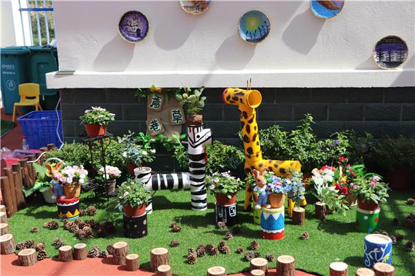 """娃娃""""和创设""""秘密小花园"""",将大湾幼儿园""""红色""""与""""绿色""""文化巧妙融合."""